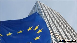 An EU flag flutters outside the  European Central Bank in Frankfurt, Germany, 27 September
