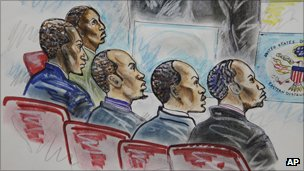 Mohammed Modin Hasan, Abdi Mohammed Gurewardher, Abdi Mohammed Umar, Gabul Abdullahi Ali, and Abdi Wali Dire at the federal court house in Norfolk