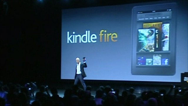 Amazon boss Jeff Bezos brandishes the Kindle Fire
