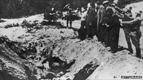 1941. Nazi commanders line up Jews to shoot them and push them into the Babi Yar ravine.