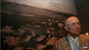 Yevgeny Yevtushenko, stands next to his poem Babi Yar at the Yad Vashem holocaust museum