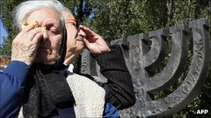 Ukrainian members of the Jewish community wipe their tears during a memorial ceremony at the Minora monument in Babi Yar in September 2007