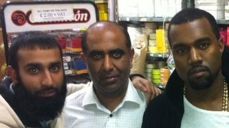 Kanye West with owners of East End fabric shop