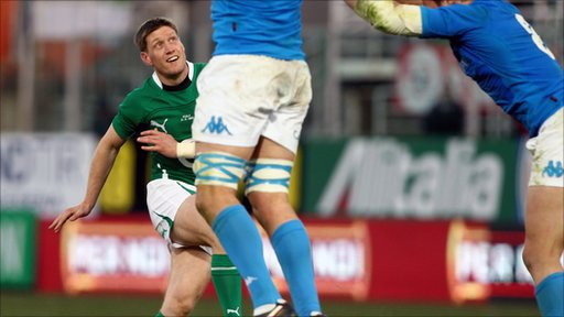 Ronan O'Gara watches his late drop goal seal victory for Ireland against Italy in Rome.
