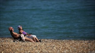 Couple sunbathing on Eastbourne beach