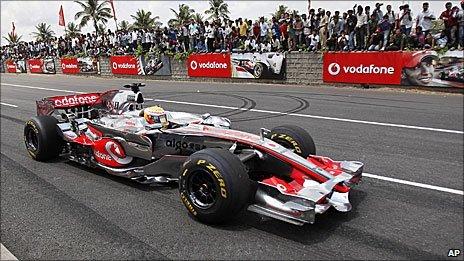 Lewis Hamilton drives a McLaren through Bangalore