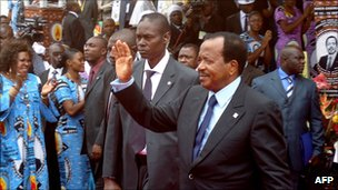 Cameroon's President Paul Biya waves to supporters during the opening of his party conference, in Yaounde
