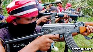 Free Aceh Movement (GAM) guerillas display their weapons in Peureulak area East Aceh in 2002