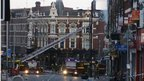 Firefighters dampen down after blaze in centre of Clapham Junction