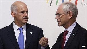 Mr Papandreou, left, and Mr Van Rompuy are meeting at an international summit in Warsaw