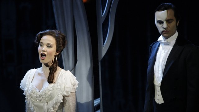 File photo, the Phantom, played by Ramin Karimloo, right, performs a scene with Christine, played by Sierra Boggess