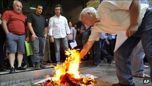 Greeks burned tax notices outside a tax office in Thessaloniki on Friday