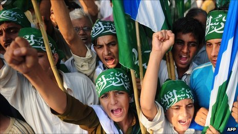 Activists of Jamaat-e-Islami Pakistan shout slogans during a protest in Karachi on September 11, 2011, on the 10th anniversary of the Sept 11 attacks in US