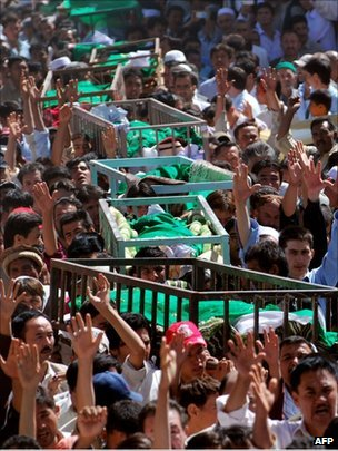 Pakistani Shia Muslims shout slogans as they carry coffins of slain community members during a funeral ceremony in Quetta on September 21, 2011