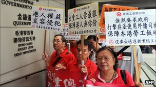 Protesters outside Hong Kong's High Court hold banners and shout slogans against the ruling of the court that immigration laws barring foreign domestic workers from applying for permanent residency were unconstitutional on September 30, 2011.