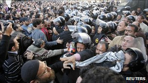 Anti-government protesters clash with police in Cairo on 25 Jan, demanding an end to Hosni Mubarak's 30-year rule