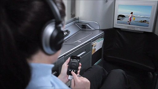 A passenger links a smart phone to an aircraft's entertainment system