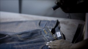 Sandblasting of a pair of jeans at a factory in Bangladesh in March 2010. Photo by Allison Joyce