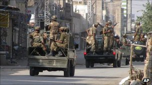 Pakistan Army troops prepare to leave for patrolling during a curfew in Bannu, a town on the edge of Pakistan&#039;s lawless tribal belt Waziristan, Saturday, Oct. 17, 2009.