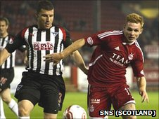 Dunfermline's Austin McCann and Fraser Fyvie chase the ball