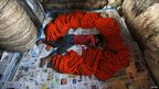 A labourer sleeps near garlands of marigold flowers at a wholesale flower market ahead of Durga Puja festival in Calcutta