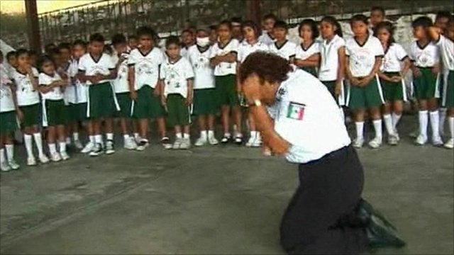 Teacher demonstrates brace to children