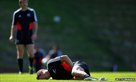 Dan Carter shows the pain after suffering a groin injury in training