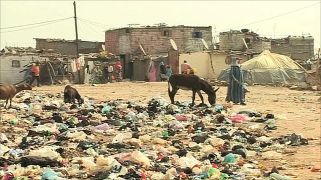 Settlement surrounded by rubbish