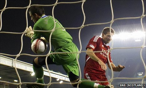 Dunfermline keeper Paul Gallacher was beaten four times at Pittodrie
