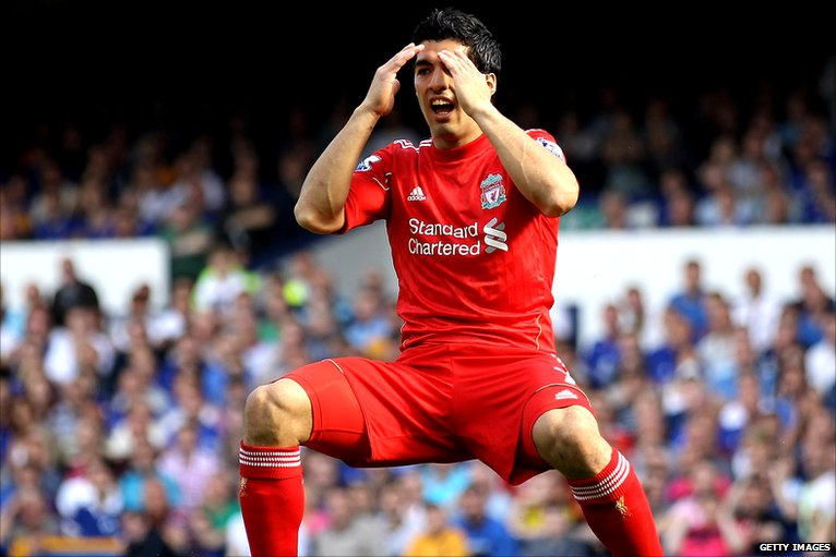 Luis Suarez reacts to missing a chance for Liverpool