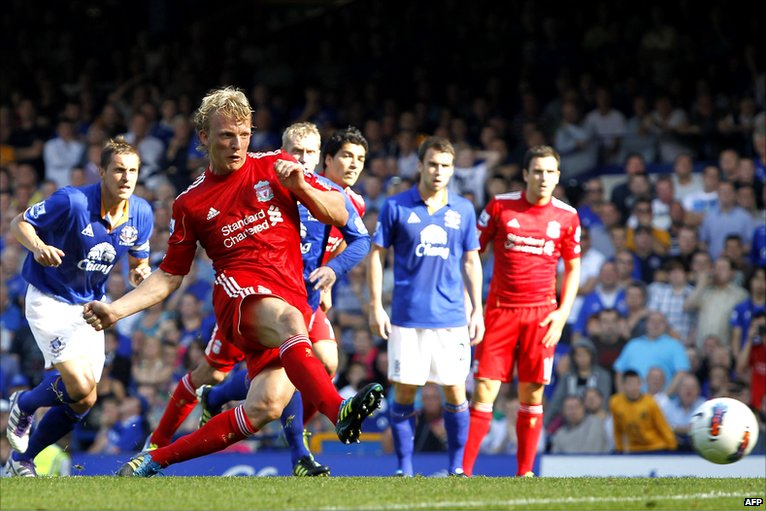 Dirk Kuyt hits a penalty for Liverpool