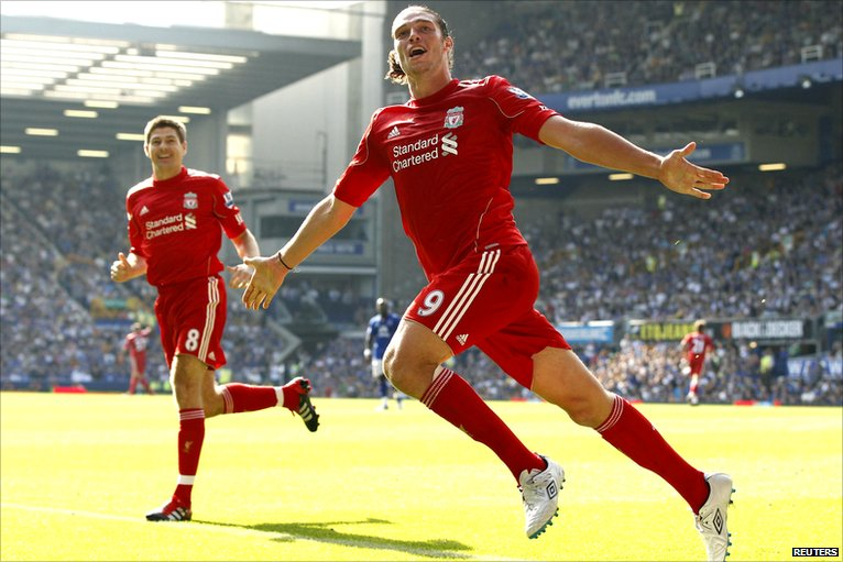 Andy Carroll celebrates Liverpool's opening goal