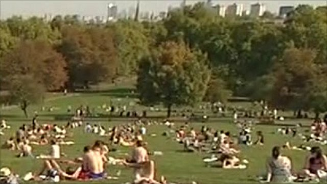 People sunbathing on London's Primrose Hill