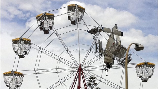 Light aircraft stuck in ferris wheel