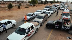 Queues of traffic at a checkpoint out of Sirte, Libya, on 2 October 2011