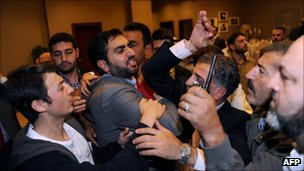 Syrian dissidents fight on the sidelines of a gathering of Syrian opposition leaders and activists in Istanbul, on October 2, 2011.