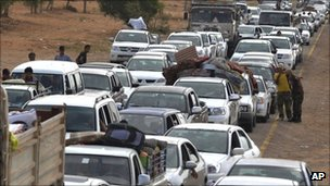 Internally displaced Libyans flee from the city of Sirte, Libya, Sunday, Oct. 2, 2011