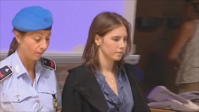 Amanda Knox walked into court with security guard