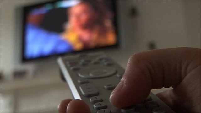 Hand on a remote control