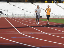 Lord Coe and Hannah England take a run on the new track