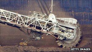 A coal dredger tears coal in an Australian mine.