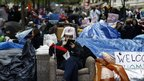 An Occupy Wall Street protester relaxes in a chair at the camp in Zuccotti Park, New York, 3 October 2011