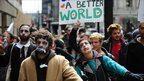 &quot;Occupy Wall Street&quot; demonstrators stage a march dressed up as corporate zombies on 3 October 2011