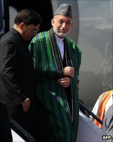 Afghanistan President Hamid Karzai (2L) arrives in Delhi on October 4, 2011.