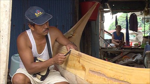 Man making a traditional canoe on Lanyu Island