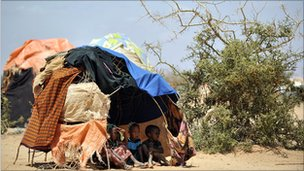 Young Somalis shelter inside a makeshift tent at a camp site in Doolow, south western Somalia - 2011
