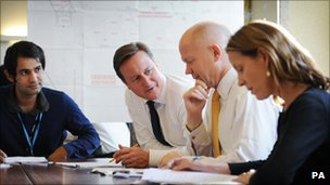 David Cameron and William Hague, with aides