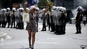 Greek demonstrator holding flowers
