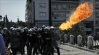 Petrol bomb explodes near Greek riot police in Athens