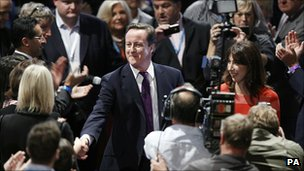 David Cameron shakes hands with activists after his speech